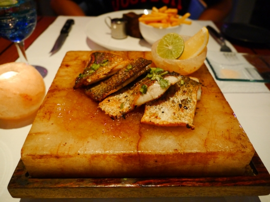 Spicy sea bass on Himalayan salt brick